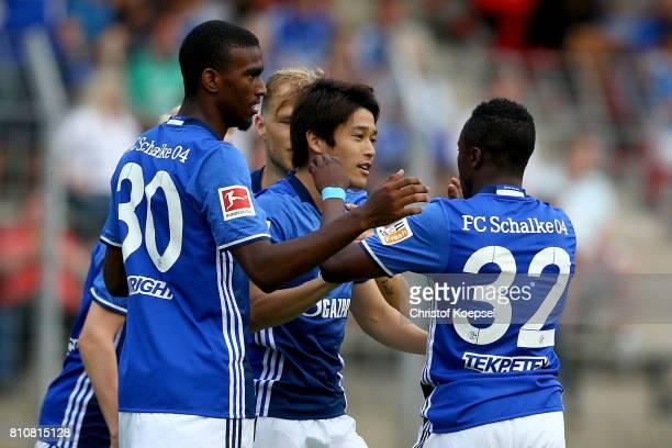 Atsuto Uchida of Schalke celebrate the forth goal with his team mates during the preseason friendly match between SpVgg Erkenschwick and FC Schalke...
