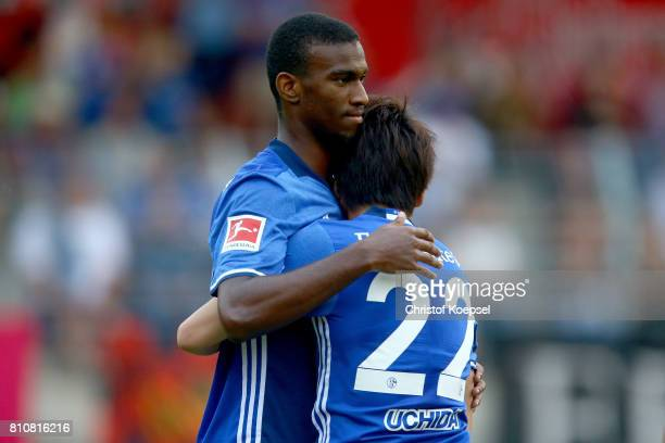 Atsuto Uchida of Schalke celebrates his second goal with Haji Wright of Schalke during the preseason friendly match between SpVgg Erkenschwick and FC...
