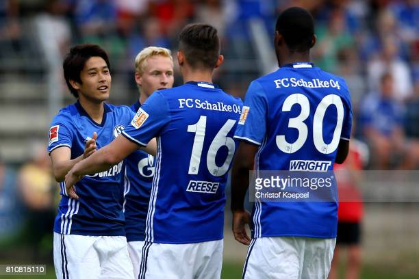 Atsuto Uchida of Schalke celebrates the forth goal with Fabian Reese during the preseason friendly match between SpVgg Erkenschwick and FC Schalke 04...