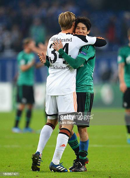 Atsuto Uchida of Schalke celebrates victory with Timo Hildebrand after the UEFA Champions League Group E match between FC Schalke 04 and FC Steaua...