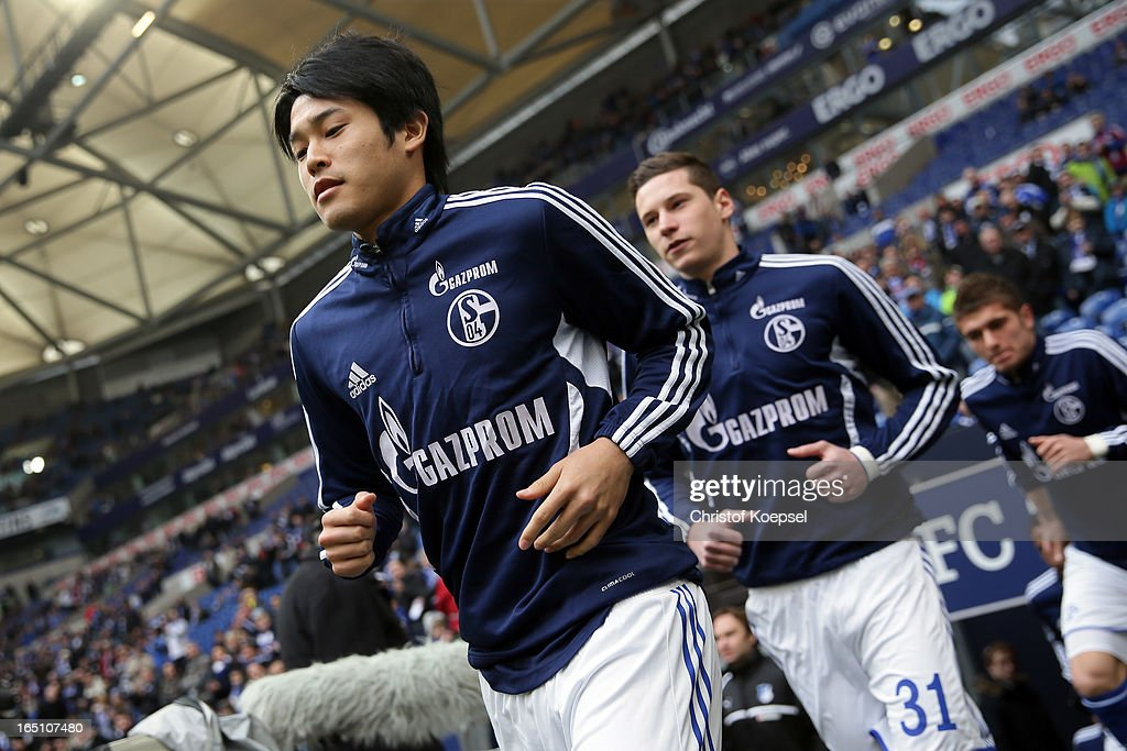 Atsuto Uchida of Schalke enters the pitch prior to the Bundesliga match between FC Schalke 04 and TSG 1899 Hoffenheim at Veltins-Arena on March 30, 2013 in Gelsenkirchen, Germany.
