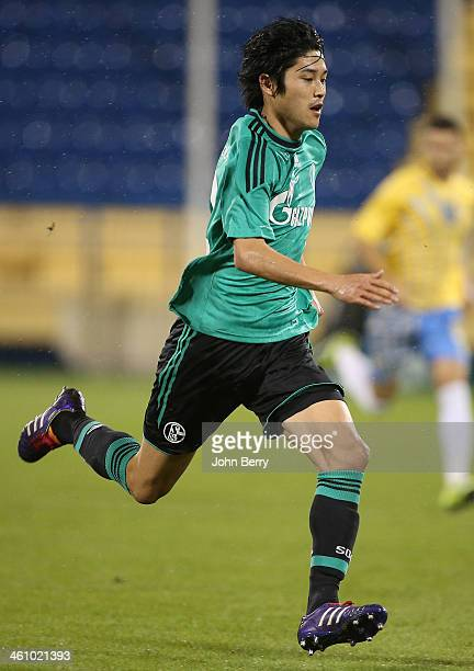 Atsuto Uchida of Schalke in action during the friendly match between Al Gharafa SC and Schalke 04 at the Al Gharafa Stadium on January 6 2014 in Doha...