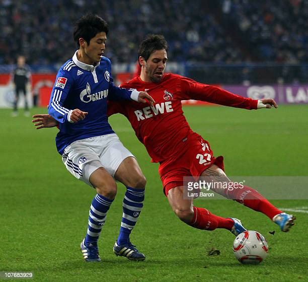 Atsuto Uchida of Schalke is challenged by Fabrice Ehret of Koeln during the Bundesliga match between FC Schalke 04 and 1 FC Koeln at Veltins Arena on...
