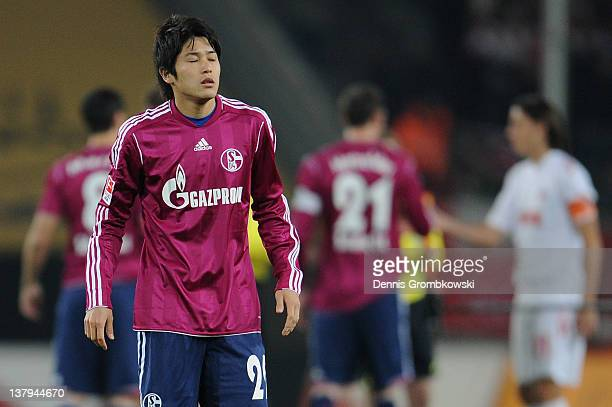 Atsuto Uchida of Schalke reacts prior to the Bundesliga match between 1 FC Koeln and FC Schalke 04 at RheinEnergieStadion on January 28 2012 in...