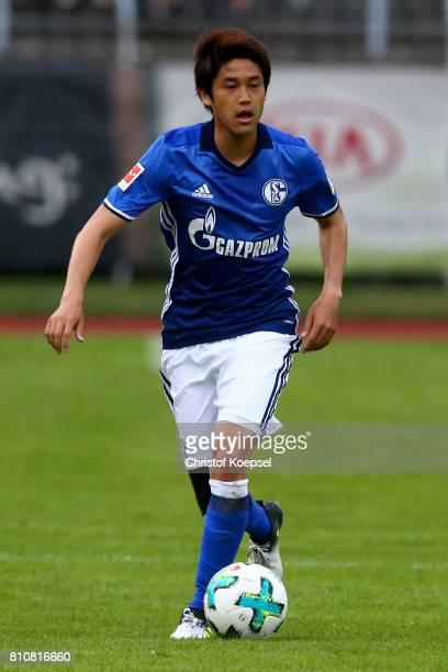 Atsuto Uchida of Schalke runs with the ball during the preseason friendly match between SpVgg Erkenschwick and FC Schalke 04 at Stimberg Stadium on...