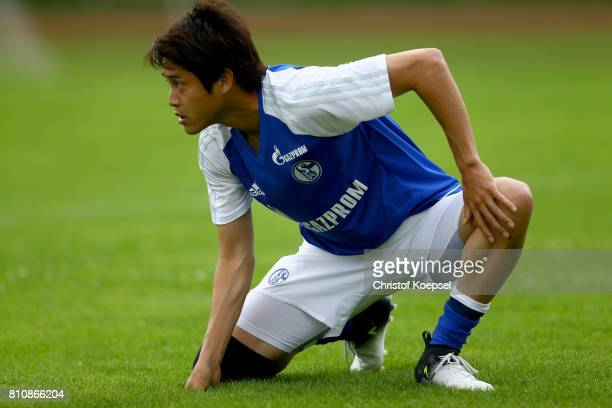 Atsuto Uchida of Schalke stretches prior to the preseason friendly match between SpVgg Erkenschwick and FC Schalke 04 at Stimberg Stadium on July 8...