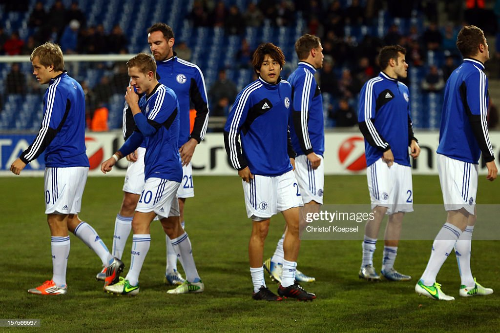<a gi-track='captionPersonalityLinkClicked' href=/galleries/search?phrase=Atsuto+Uchida&family=editorial&specificpeople=4318608 ng-click='$event.stopPropagation()'>Atsuto Uchida</a> of Schalke warms up prior to the UEFA Champions League group B match between Montpellier Herault SC and FC Schalke 04 at Stade de la Mosson on December 4, 2012 in Montpellier, France.