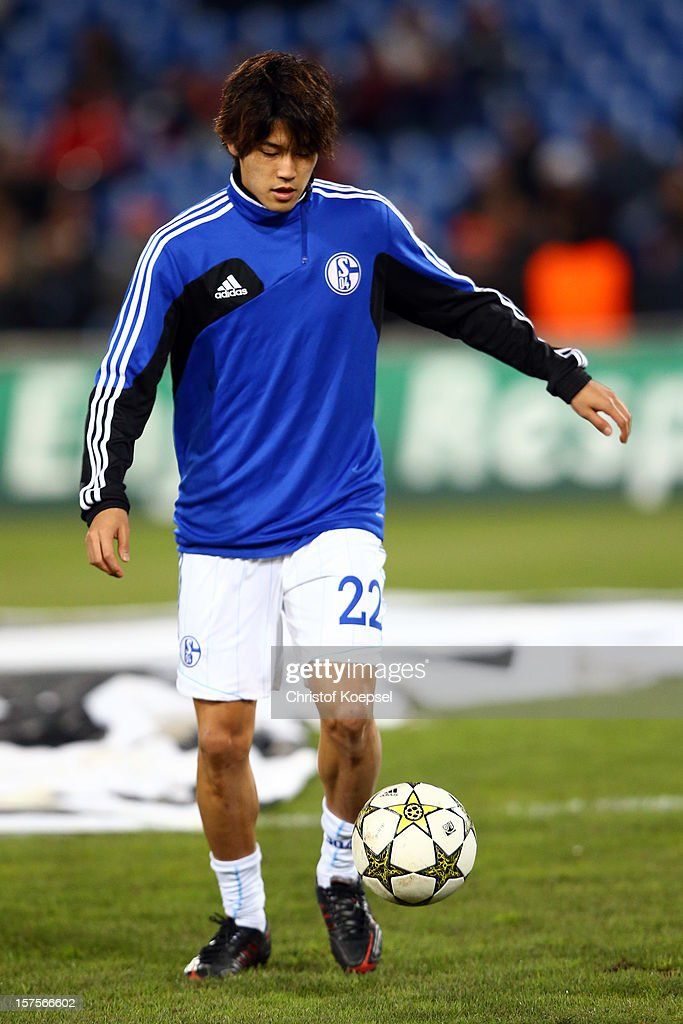 Atsuto Uchida of Schalke warms up prior to the UEFA Champions League group B match between Montpellier Herault SC and FC Schalke 04 at Stade de la Mosson on December 4, 2012 in Montpellier, France.