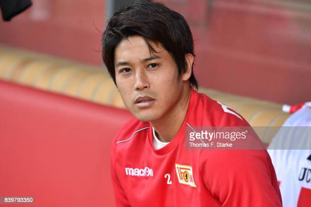 Atsuto Uchida sits on the substitutes bench prior to the Second Bundesliga match between 1 FC Union Berlin and DSC Arminia Bielefeld at Stadion An...