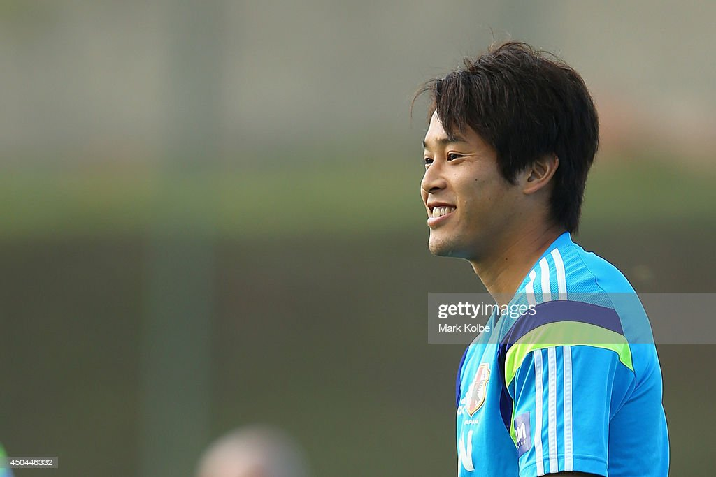 <a gi-track='captionPersonalityLinkClicked' href=/galleries/search?phrase=Atsuto+Uchida&family=editorial&specificpeople=4318608 ng-click='$event.stopPropagation()'>Atsuto Uchida</a> smiles as he watches on during a Japan training session at the Japan national team base camp at the Spa Sport Resort on June 11, 2014 in Itu, Sao Paulo.