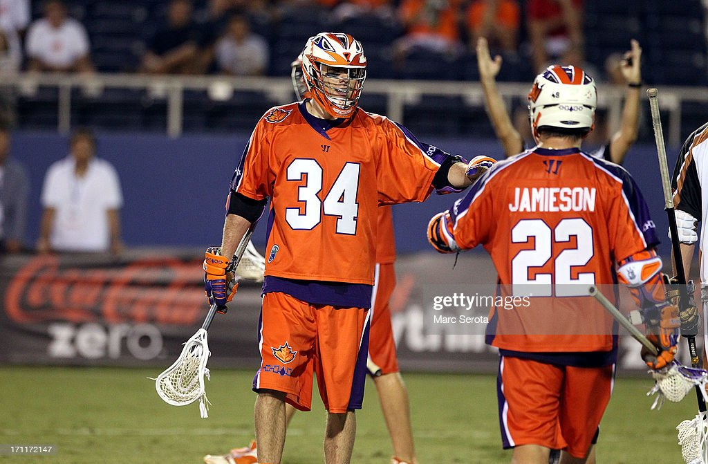 Attacker Cody Jamieson #22 of the Hamilton Nationals celebrates a score with teammate Martin Cahill #34 during the third quarter against the Rochester Rattlers at FAU Stadium on June 22, 2013 in Boca Raton, Florida. The Nationals defeated the Rattlers 17-11.