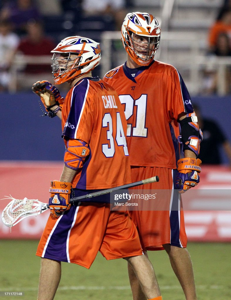 Attacker Kevin Crowley #21 of the Hamilton Nationals celebrates a score with teammate Martin Cahill #34 during the third quarter against the Rochester Rattlers at FAU Stadium on June 22, 2013 in Boca Raton, Florida. The Nationals defeated the Rattlers 17-11.