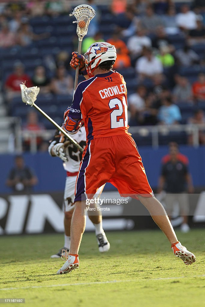 Attacker Kevin Crowley #21 of the Hamilton Nationals scores against the Rochester Rattlers at FAU Stadium on June 22, 2013 in Boca Raton, Florida.