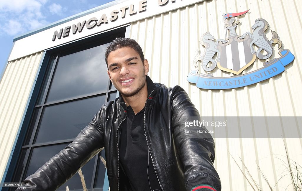 Attacking Midfielder <a gi-track='captionPersonalityLinkClicked' href=/galleries/search?phrase=Hatem+Ben+Arfa&family=editorial&specificpeople=825038 ng-click='$event.stopPropagation()'>Hatem Ben Arfa</a> poses for photographs at Newcastle United's training ground after signing a season long loan on August 28, 2010 in Newcastle-upon-Tyne, England.