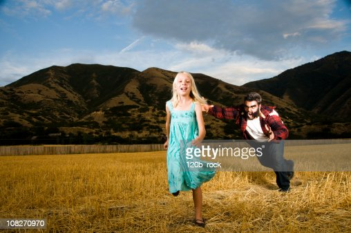 attacking young girl : Stock Photo