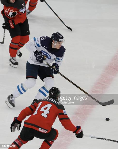 Atte Ohtamaa of Finland in action with Sean Couturier of Canada during the 2017 IIHF Ice Hockey World Championship game between Canada and Finland at...
