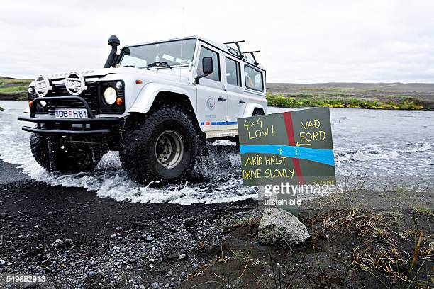 4WD attempting water crossing on the F88 highlands road Iceland