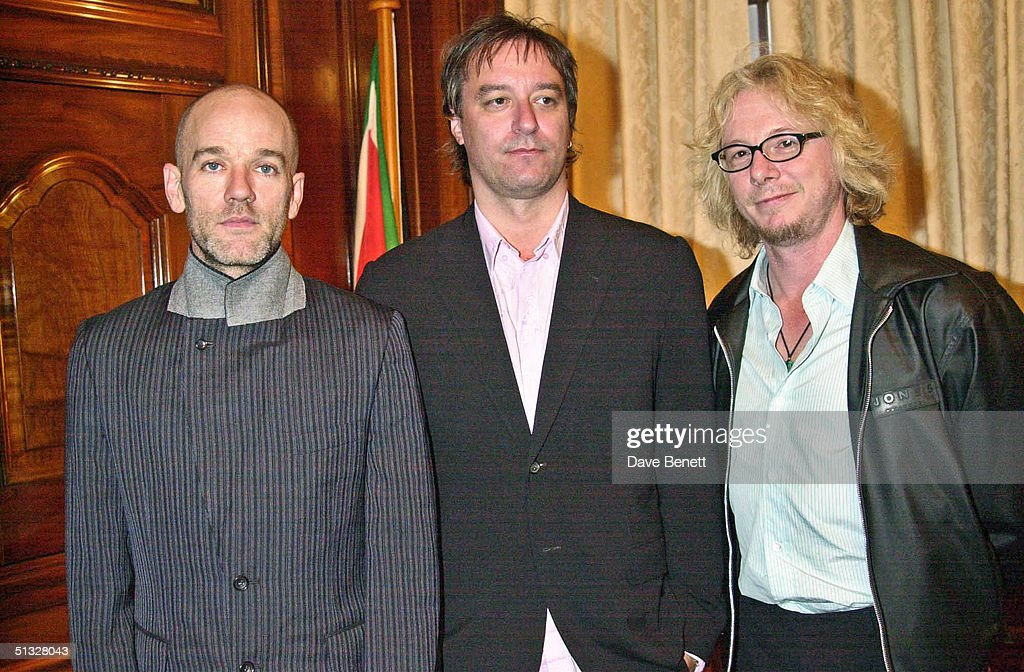 REM attend the South Africa 'Freedom Day' Concert in Trafalgar Square on April 30, 2001 in London.