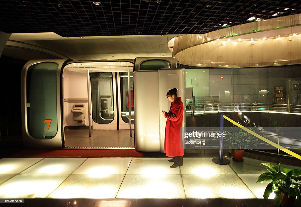 A attendant waits for customers in front of a shuttle train at the Bund Sightseeing Tunnel on the Bund in Shanghai, China, on Tuesday, Jan. 29, 2013. China's economic growth accelerated for the first time in two years as government efforts to revive demand drove a rebound in industrial output, retail sales and the housing market. Photographer: Tomohiro Ohsumi/Bloomberg via Getty Images
