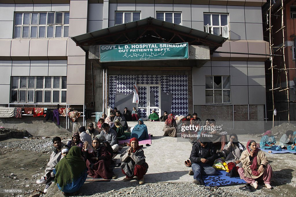 Attendants and patients waiting for their turn for Medical checkup at Lal Ded Hospital after curfew was lifted from some parts of valley after five days on February 13, 2013 in Srinagar, India. Curfew was was imposed by the authorities last Saturday to control Law and order situation after the execution of Parliament attack convict Afzal Guru.