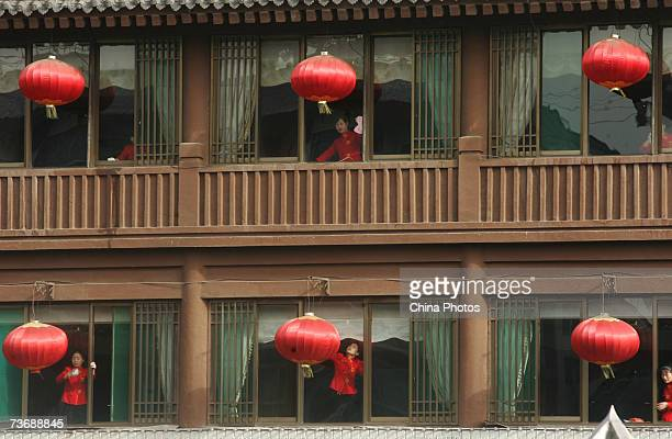 Attendants clean windows of a restaurant during an event to help the old tourist city head for the statelevel clean city on March 24 2007 in Xian of...