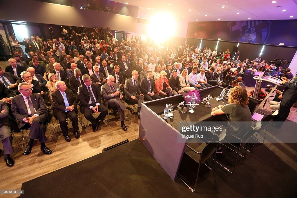 Attendants pay attention to Xavi Hernandez's speech during the farewell press conference as Puyol leaves FC Barcelona at the Auditorium 1899 on May 15, 2014 in Barcelona, Spain.