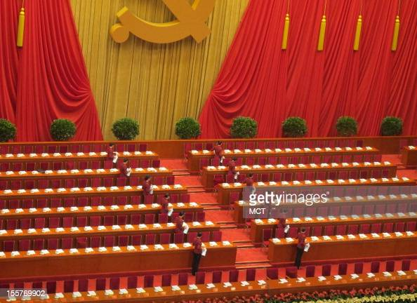 Attendants pour tea in unison before the start of the Chinese Communist Party's 18 the National Congress on Thursday November 8 in Beijing China