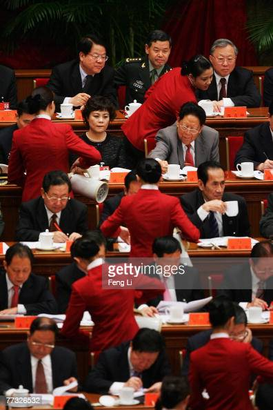 Attendants service the tea during the opening session of the fiveyearly Chinese Communist Party Congress at the Great Hall of the People on October...