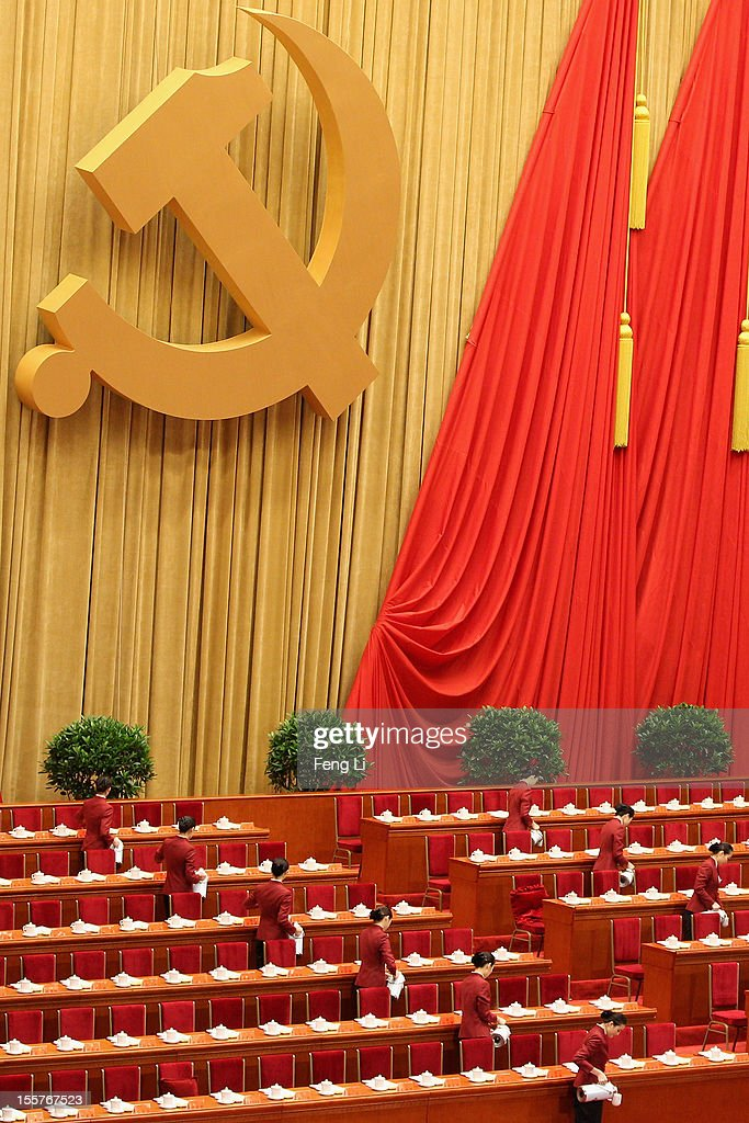 Attendants to serve tea during before the opening session of the 18th Communist Party Congress held at the Great Hall of the People on November 8, 2012 in Beijing, China. The Communist Party Congress will convene from November 8-14 and will determine the party's next leaders.