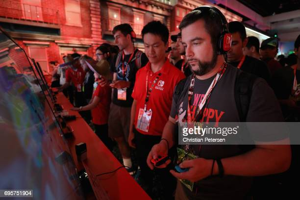 Attendee Brad Linaberry plays the Nintendo Switch during the Electronic Entertainment Expo E3 at the Los Angeles Convention Center on June 13 2017 in...