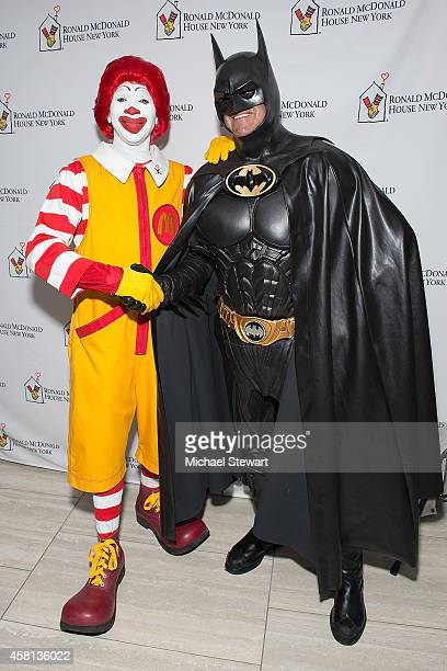 Attendee dressed as Ronald McDonald and Lenny Robinson dressed as Batman attend the 2014 Masquerade Ball Benefiting Ronald McDonald House at Apella...