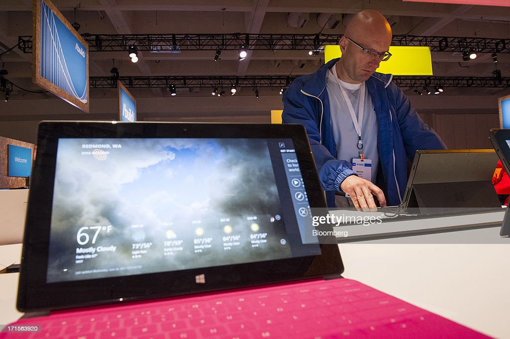 Attendee Mariusz Trzaska looks at a Microsoft Corp. Surface Tablet during the Microsoft Corp. Build Developers Conference in San Francisco, California, U.S., on Wednesday, June 26, 2013. Facebook Inc. is building an application for Microsoft Corp.'s Windows 8, adding one of the most popular programs still missing from the operating system designed to help Microsoft gain tablet customers. Photographer: David Paul Morris/Bloomberg via Getty Images
