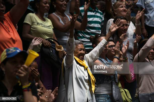 Attendees applaud while Henrique Capriles opposition leader and governor of the State of Miranda not pictured speaks during an event marking his last...