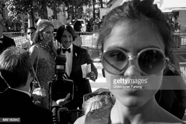 attendees are photographed outside the Hotel Barrire Le Majestic Cannes during the Cannes Film Festival at Palais des Festivals on May 20 2017 in...