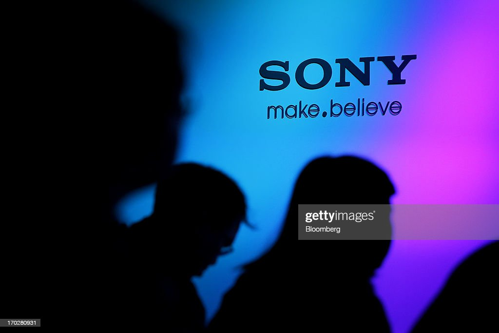 Attendees are silhouetted against a wall displaying the Sony Corp. logo during a product launch for the company's Vaio Ultrabook laptop computers in Tokyo, Japan, on Monday, June 10, 2013. Sony Corp. is Japan's biggest consumer-electronics exporter. Photographer: Kiyoshi Ota/Bloomberg via Getty Images