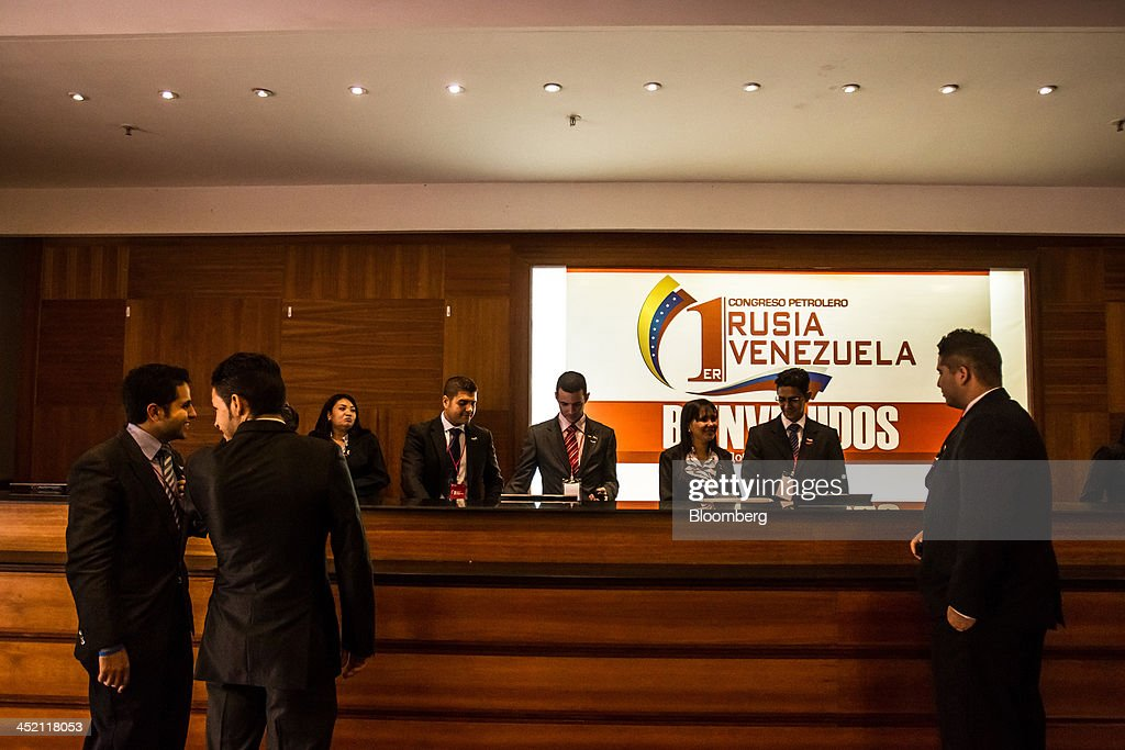 Attendees arrive at the state-owned Venetur Hotel for the first Russia-Venezuela Oil Congress on Margarita Island in Nueva Esparta, Venezuela, on Thursday, Nov. 21, 2013. OAO Rosneft, Russia's largest oil producer, plans to invest $13 billion in five projects in Venezuela over five years and buy at least part of OAO Lukoil's stake in a producing field in the South American nation. Photographer: Meridith Kohut/Bloomberg via Getty Images