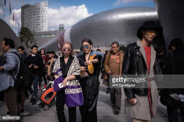 Attendees arrive during Seoul Fashion Week at Dongdaemun Design Plaza in Seoul on October 19 2017 For Seoul's flamboyant followers of fashion the...