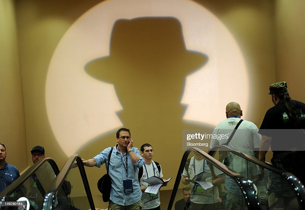 Attendees arrive during the Black Hat USA 2012 conference at Caesar's Palace resort and casino in Las Vegas, Nevada, U.S., on Wednesday, July 25, 2012. The conference brings together leaders from all facets of the information security world, from corporate and government sectors to academic and even underground researchers. Photographer: Jacob Kepler/Bloomberg via Getty Images