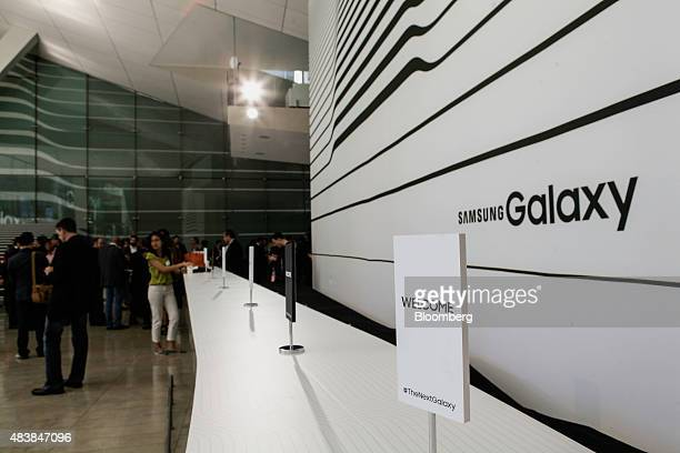 Attendees arrive for the Samsung Electronics Co Unpacked 2015 event in New York US on Thursday Aug 13 2015 Samsung will get the jump on Apple before...
