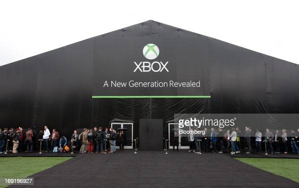 Attendees arrive to a Microsoft Corp unveiling for the first new Xbox in almost eight years in Redmond Washington US on Tuesday May 21 2013 The...