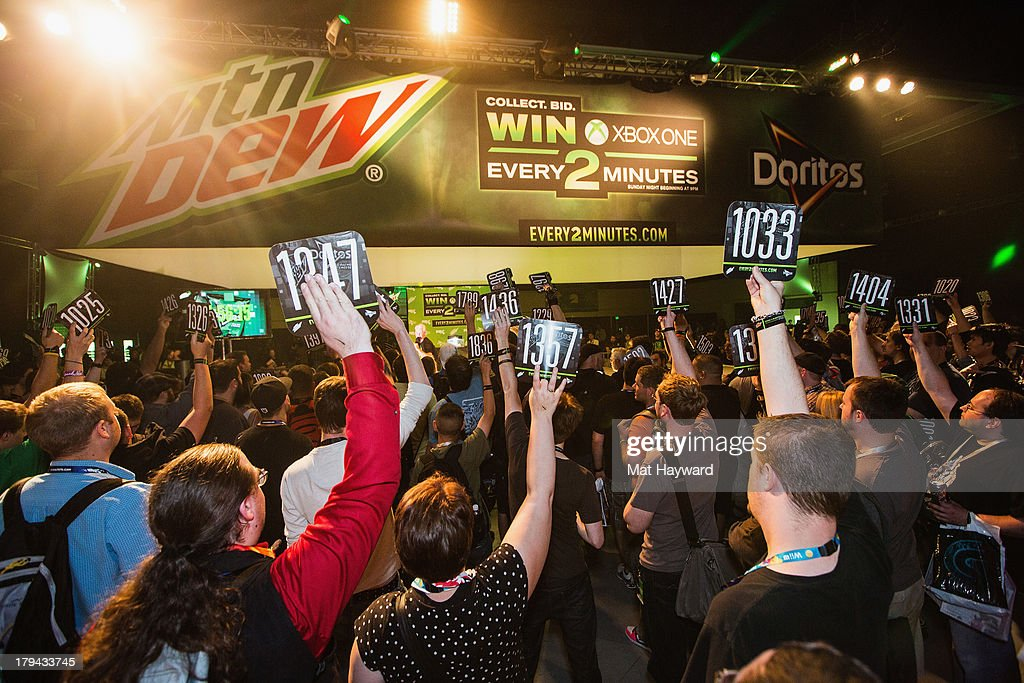 PAX attendees at the Mountain Dew® and Doritos® 'Every 2 Minutes' live auction event place their bids on Sunday night. Mountain Dew and the Doritos brand offered 30 Xbox One entertainment systems for the live auctions on September 1, 2013 in Seattle, Washington.