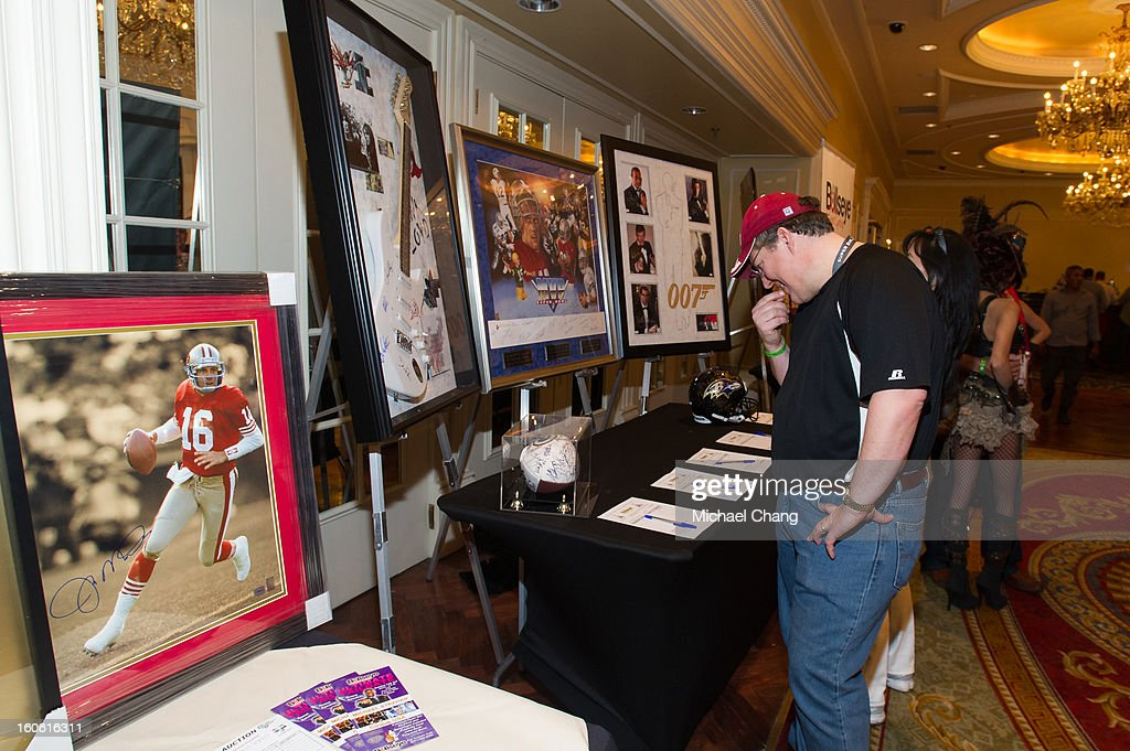 Attendees browse items up for auction during the Ultimate Super Bowl Tailgate Party hosted by Michael Strahan at Harrah's Casino on February 3, 2013 in New Orleans, Louisiana.
