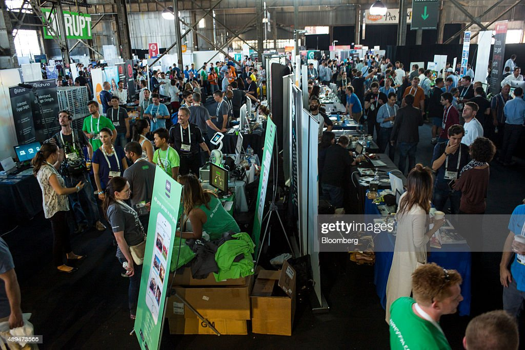 Attendees browse various startup companies in Startup Alley during the TechCrunch Disrupt SF 2015 conference in San Francisco California US on Monday...