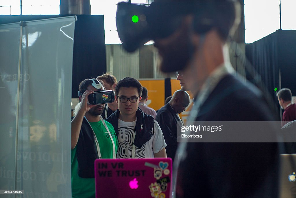 Attendees browse VirtualReality headsets in Startup Alley during the TechCrunch Disrupt SF 2015 conference in San Francisco California US on Monday...