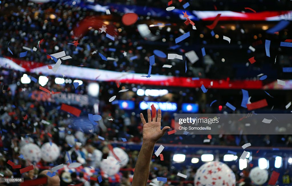 Attendees celebrate as confetti and balloon drop after Republican presidential candidate former Massachusetts Gov Mitt Romney accepted the nomination...