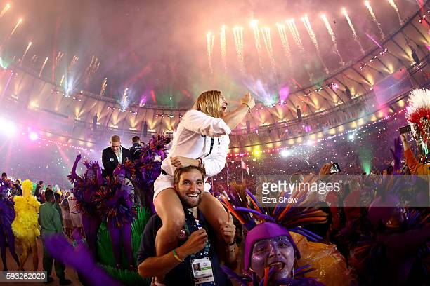 Attendees celebrate as fireworks explode during the Closing Ceremony on Day 16 of the Rio 2016 Olympic Games at Maracana Stadium on August 21 2016 in...