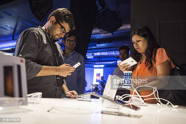 Attendees check out the Xiaomi Corp MI 5 smartphone during the launch of the device in New Delhi India on Thursday March 31 2016 Foxconn Technology...