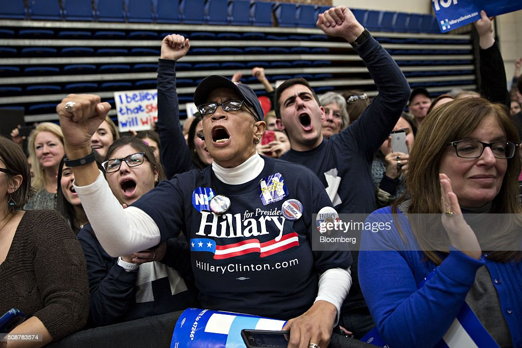 Attendees cheer as Hillary Clinton, former Secretary of State and 2016 Democratic presidential candidate, not pictured, speaks during a campaign event in Concord, New Hampshire, U.S., on Saturday, Feb. 6, 2016. Trailing Bernie Sanders in the Democratic contest by 20 percentage points or more in some polls of voters in the state, Clinton recalled that New Hampshire gave her a come-from-behind victory in the 2008 primary race and a dramatic boost to her husband, Bill Clinton, in his first run for the presidency in 1992. Photographer: Daniel Acker/Bloomberg via Getty Images