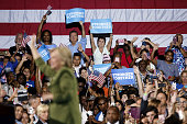 Attendees cheer as Hillary Clinton presumptive 2016 Democratic presidential nominee arrives on stage during a campaign event in Tampa Florida US on...