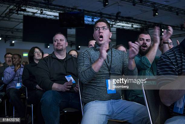 Attendees cheer during a keynote session at the Microsoft Developers Build Conference in San Francisco California US on Thursday March 31 2016...